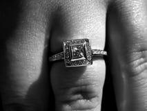 Engagement Ring. Closeup detail of a custom made princess cut diamond engagement ring Stock Photo