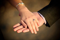 Engagement ring. On the hand of the bride Stock Images