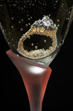 Engagement Ring. Diamond engagement ring in champagne glass Stock Photography