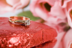 Engagement Ring. A gold engagement ring with heart and flowers royalty free stock photo
