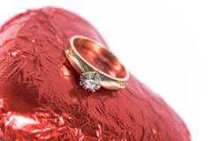 Engagement ring. A gold engagement ring with heart on white royalty free stock image
