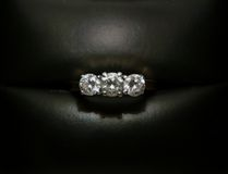 Engagement Ring. 3 stone diamond ring in jewel box Stock Photos