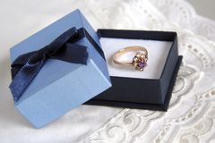Engagement ring. Picture of engagement ring in blue box stock photography