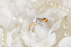 Engagement ring. Beautiful engagement ring and flowers stock images