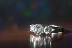 Engagement ring. A beautiful white gold engagement ring with 3 diamonds royalty free stock photography