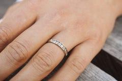 Engagement ring. On a beautyful girls finger Stock Photo
