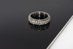 Engagement ring on the black glass Royalty Free Stock Photo