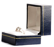 Engagement ring in a box. Diamond engagement ring in blue box on a white background Royalty Free Stock Photos