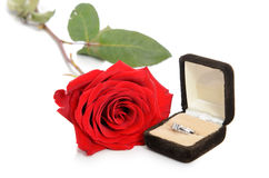 Engagement Ring Box. A diamond engagement ring in a jewellery box, shot next to a red rose,  against a white background Stock Photography