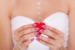 Engagement ring box in woman bride hands. Stock Images