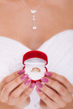 Engagement ring box in woman bride hands. Royalty Free Stock Photos