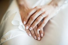 Engagement ring on bride`s finger. Wedding day.  Royalty Free Stock Image