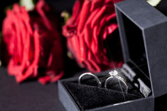 Engagement ring with a bunch of red roses Stock Photography