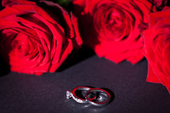 Engagement ring with a bunch of red roses Stock Photo