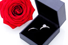 Engagement ring with a bunch of red roses Royalty Free Stock Image