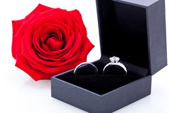Engagement ring with a bunch of red roses Royalty Free Stock Images
