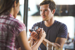Engagement ring in cafe. Young men is giving the engagement ring in cafe stock images