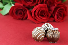 Engagement Ring and Chocolates Stock Photos