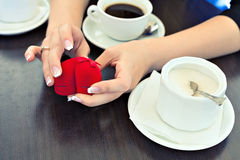 Engagement ring and coffee Royalty Free Stock Photos