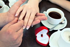 Engagement ring and coffee Royalty Free Stock Photography