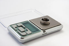 Engagement ring on a digital scale Stock Images