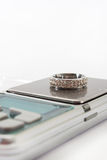 Engagement ring on a digital scale.  Royalty Free Stock Photos