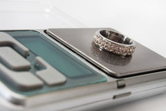 Engagement ring on a digital scale Stock Photography