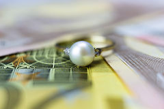 Engagement ring. On euro banknotes Stock Images