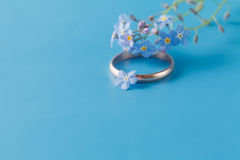 Engagement ring with forget-me-not / Romantic scene Royalty Free Stock Image