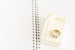 Engagement ring and gift box on note book Royalty Free Stock Photo