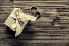 Engagement ring with gift box - wood background royalty free stock photo