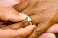 Engagement ring and hands Royalty Free Stock Photography