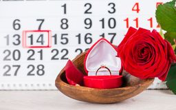 Engagement ring, heart, calendar, February 14, a gift for Valent. Ine`s Day royalty free stock image