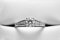 Engagement Ring in Leather casing. Channel-set engagement diamond ring in leather casing stock images