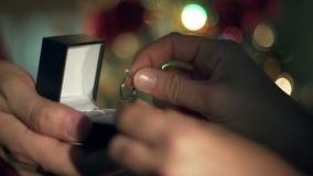 Engagement Ring Proposal Close Up Hands. Christmas Tree Background stock video footage