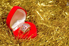 Engagement ring in a red box. Engagement ring on a christmas tinsel Stock Photography