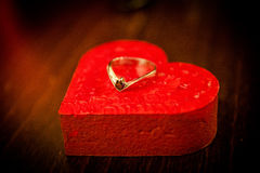 Engagement ring on a red heart Royalty Free Stock Photos