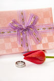 Engagement ring with red tulip and pink gift box Stock Photo