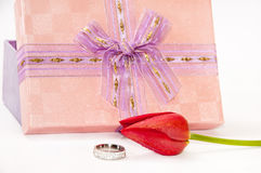 Engagement ring with red tulip and pink gift box Stock Photography
