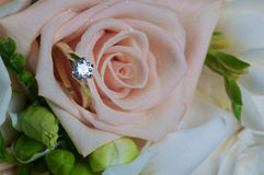 Engagement ring and rose Stock Photography