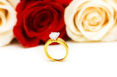 Engagement ring and roses. At the background Royalty Free Stock Photo