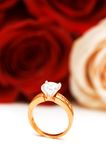 Engagement ring and roses. At the background Royalty Free Stock Images