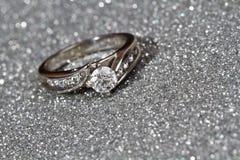 Engagement Ring on silver. White Gold diamond engagement ring on silver with black background stock photos