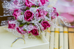 Engagement ring. Surrounded by bouquets of flowers and sweets Royalty Free Stock Photos