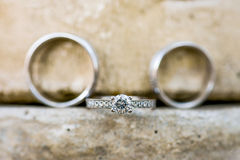 Engagement Ring with Wedding Rings Stock Photos