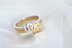 Engagement ring on white veil Stock Photo