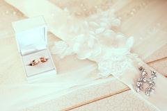 Engagement ring in white wedding box with bride ear-rings on vei Stock Images