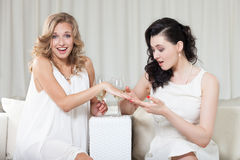 Engagement ring. Woman showing engagement ring to her best friend Stock Image