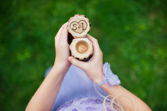 Engagement rings in a decorative wooden box at a girl in hand Stock Images