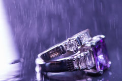 Engagement rings. With droplets on dark background Royalty Free Stock Photos
